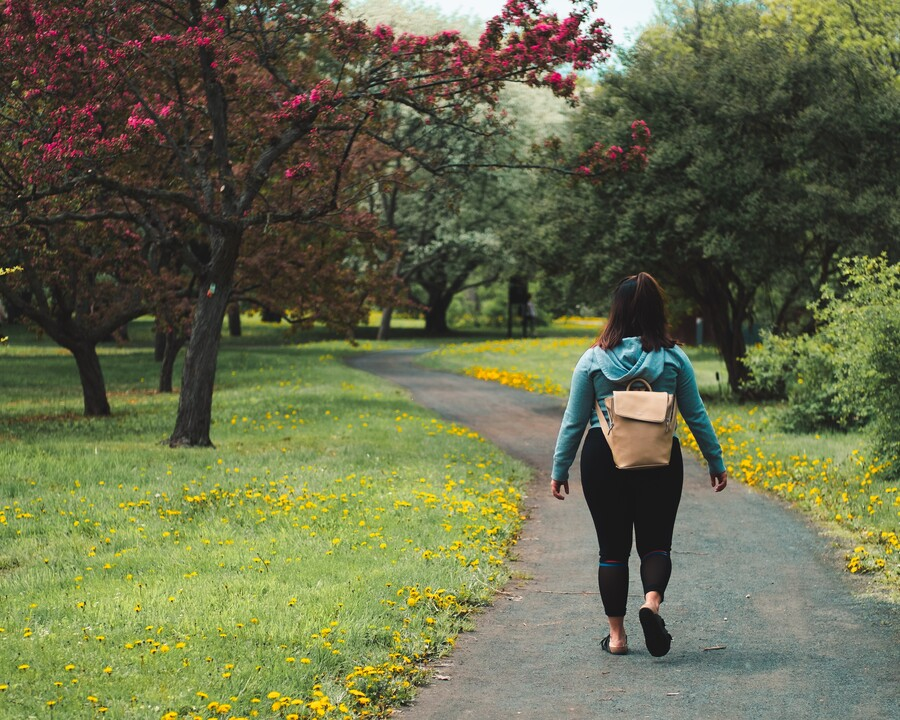 Image of woman on a walking path